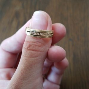 Size 8 ring14k gold with 8 small (real) diamonds.